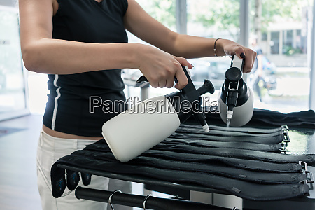 trainer preparing special conductive suits in