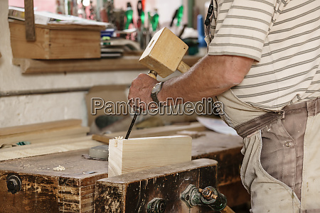 carpenter at his workbench working on
