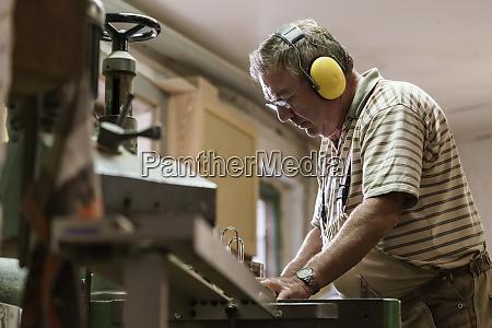 carpenter in his wood workshop working