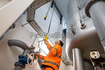 worker in the waterworks or water