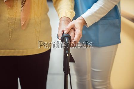 nurse in nursing home helping a