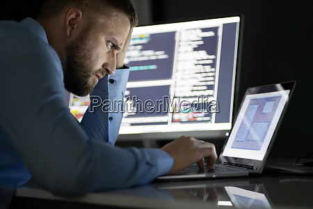 worried programmer working late at night