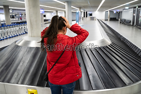 upset woman lost baggage while traveling