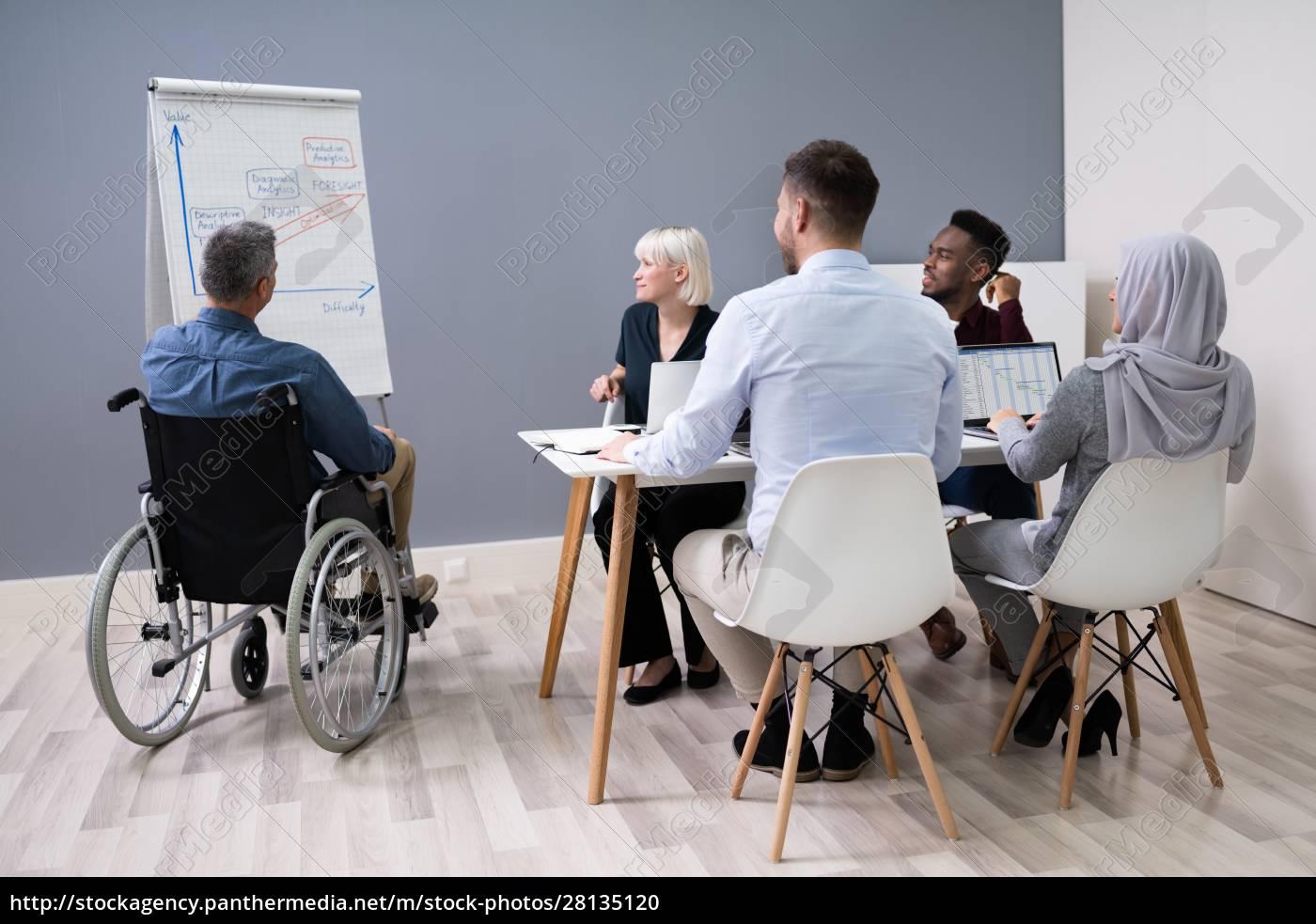 disables, businessman, giving, presentation - 28135120