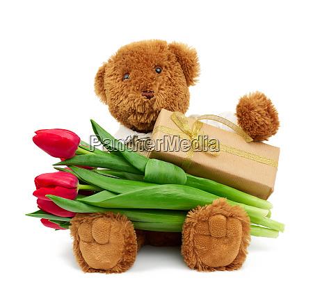 brown teddy bear sits on an