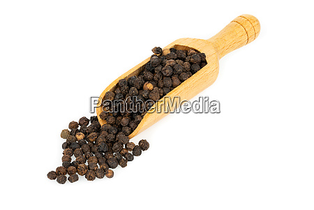 a small wooden spice shovel filled