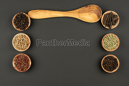 six small wooden bowls filled with