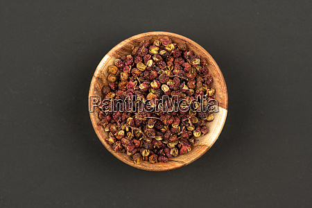 a small wooden bowl filled with