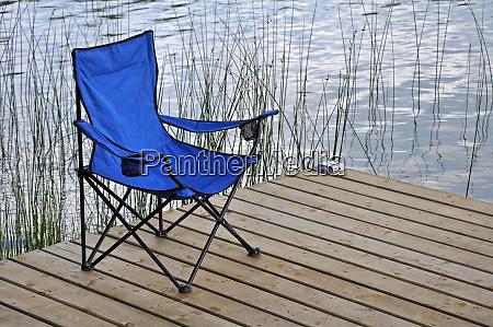 blue beach chair on dock