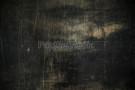 black wooden board scratched