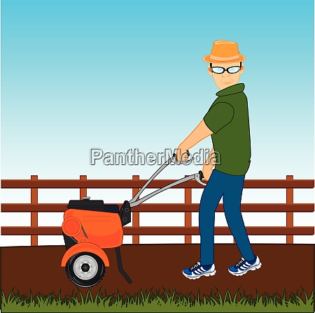 man with walking tractor works at