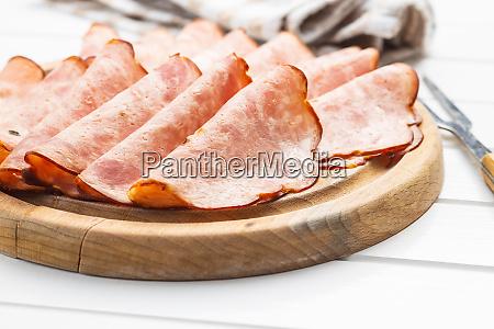 sliced salami sausage smoked ham