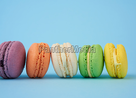 multi colored round baked macarons cakes