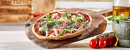crusty oven fired italian prosciutto pizza