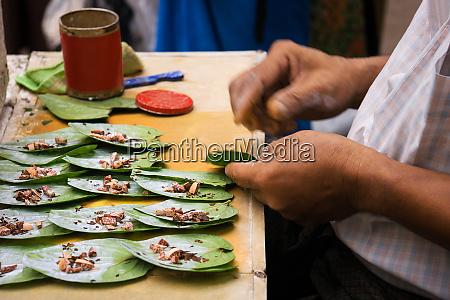 men preparing betel chew myanmar