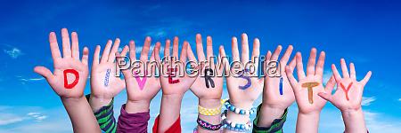 children hands building word diversity blue