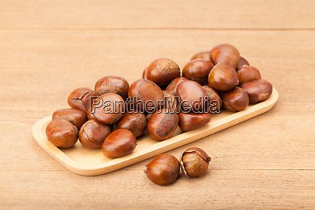 chestnut in wooden plate