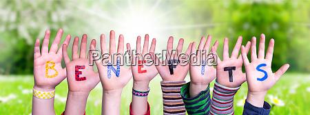 children hands building word benefits grass