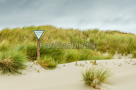 dune protected area warning sign on