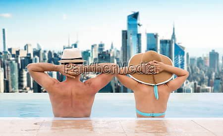 couple in infinite swimming pool in