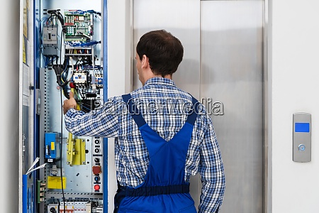 technician repairing elevator