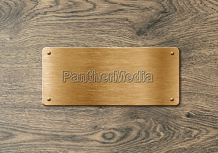 blank polished golden name plate on