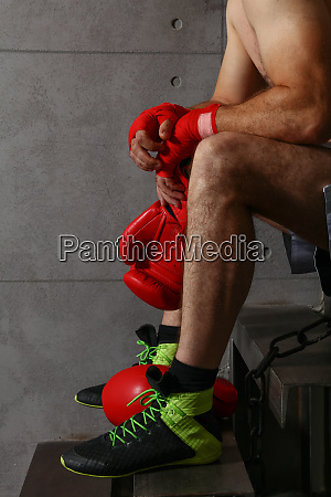 tired boxer sitting resting after training