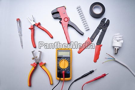 electrician tools on gray background