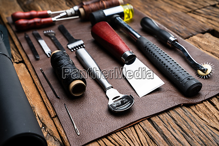 leather craft tools on desk