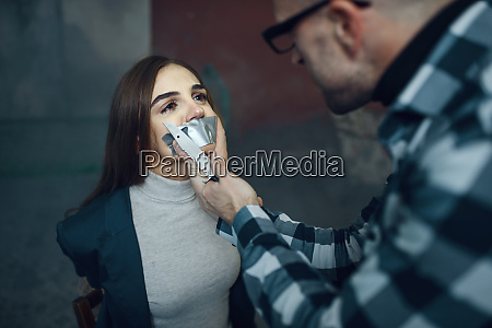 maniac kidnapper taping his victims mouth