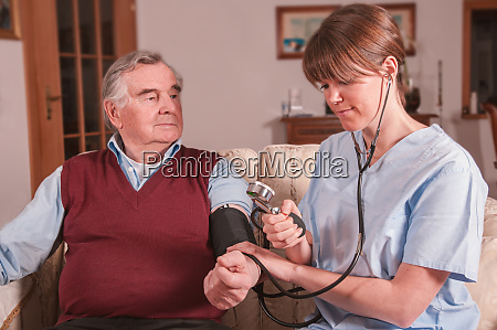 young nurse taking care of senior