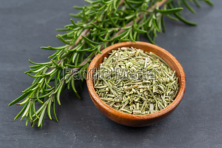 fresh rosemary twigs and a wooden