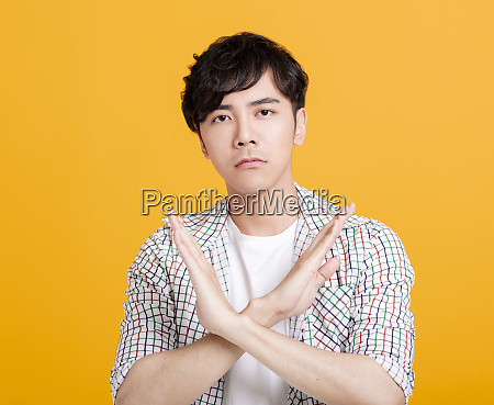young man refuse gesture crossed hands