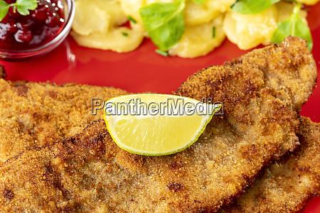 wiener schnitzel with potato salad on