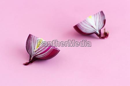 purple onion on a light pink