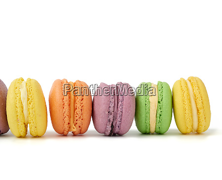 multicolored round baked macaroon cakes isolated