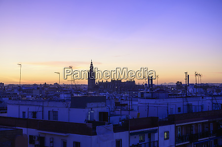cityscape with giralda bell tower at