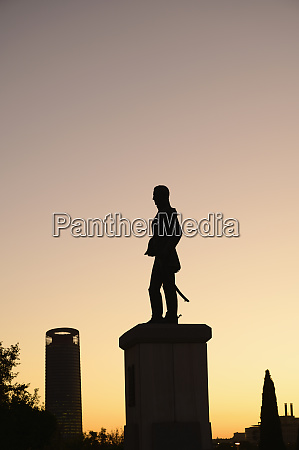 silhouette of statue at sunset in
