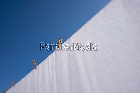pegs and sheet on washing line