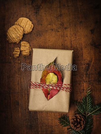 leaves tied to christmas present next