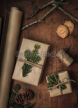 pine fronds tied to christmas presents