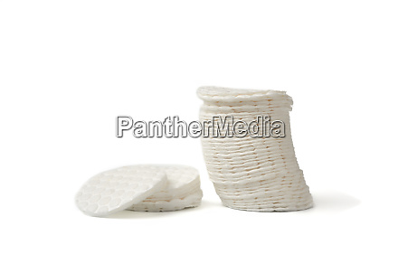 stack of white cotton pads isolated