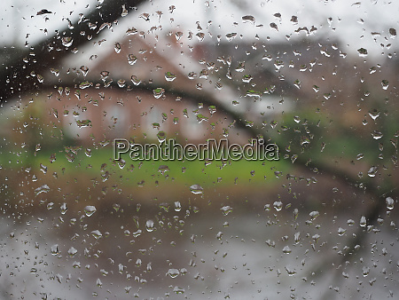 windowpane raindrops blurred