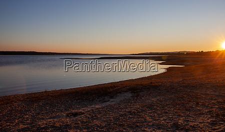 sunset at the montargil reservoir ponte
