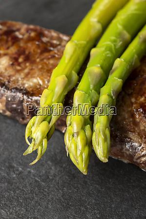 green asparagus on a steak