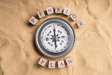 pension plan compass on sand