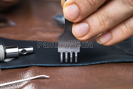 cobbler working with leather
