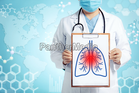 doctor showing blank clipboard for