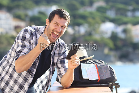 excited traveller celebrating news on his