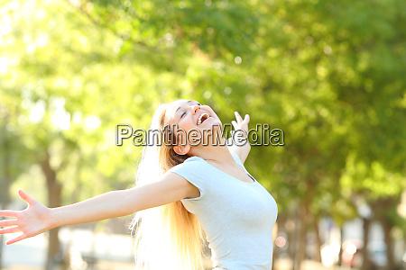 happy teenage girl stretching arms celebrating